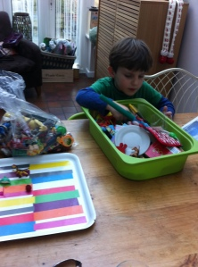 Freddie searched through his old toys for anything small