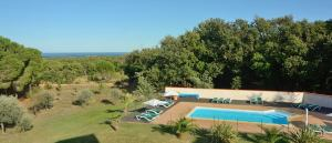 Pool view and distant sea view from the three bedroom holiday apartments